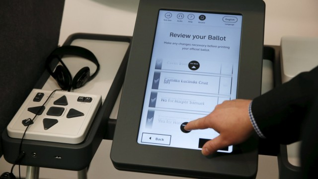 Los Angeles County Registrar-Recorder/County Clerk Dean Logan demonstrates a prototype of a new touchscreen voting machine in Norwalk