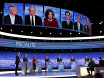 French politicians attend the first prime-time televised debate for the French conservative presidential primary in La Plaine Saint-Denis, near Paris