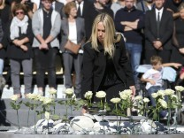 White roses are placed during the ceremony in tribute to the victims and the families of the fatal truck attack three months ago, in NIce