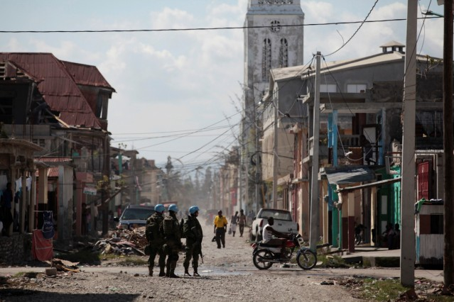 Brazilian peacekeepers secure the perimeter of the Lycee Philippe Guerrier before the visit of UN Secretary General Ban Ki Moon after Hurricane Matthew in Les Cayes, Haiti