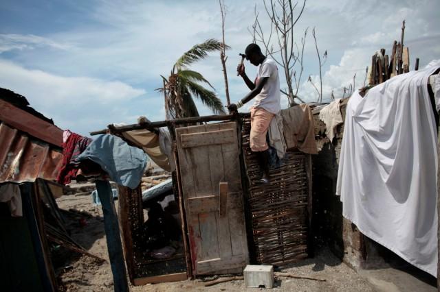 A man builds a new house after Hurricane Matthew in Chardonnieres, Haiti