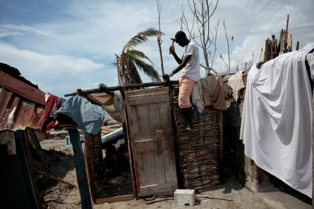 A man builds a new house after Hurricane Matthew in Chardonnieres, Haiti