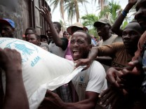 Residents try to get a sack of rice following Hurricane Matthew in Saint Jean du Sud