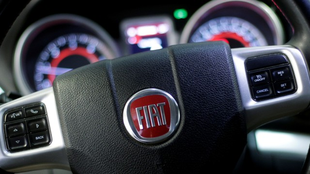 The Fiat logo is seen on the steering wheel of a Fiat 'Freemont' model at a mechanic's workshop in Rome