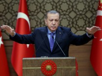 Turkish President Tayyip Erdogan makes a speech during his meeting with mukhtars at the Presidential Palace in Ankara