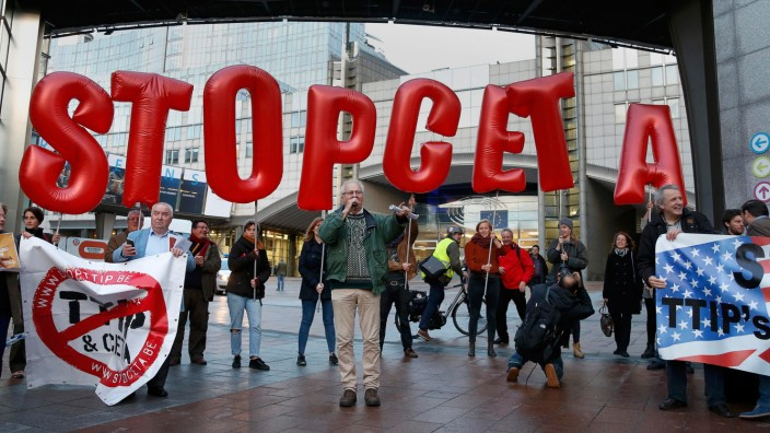 Demonstrators protest against CETA outside the EU summit in Brussels