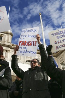 Opponents of Airbnb rally before a hearing called at City Hall in New York