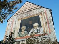 Wandbild an der Hausfassade des Bremer AWO Hauses an der Straße Auf den Häfen Es zeigt ein altes Eh