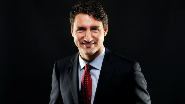 Canada's PM Trudeau poses for a picture in Toronto