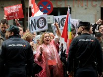 Supporters of Spain's Socialist party (PSOE) shout slogans and hold posters during a protest outside Spain's Socialist party (PSOE) headquarters in Madrid, Spain
