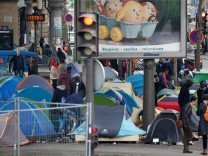 Tents are seen at a makeshift migrant camp on a street near the Stalingrad metro station in Paris