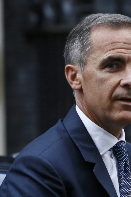 Bank of England governor Mark Carney arrives at Number 10 Downing Street in central London
