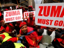 Protestors call for the removal of President Jacob Zuma outside court in Pretoria, South Africa