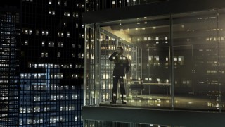 Man in an office by night