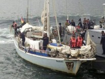 Filipino soldiers recover an abandoned yacht with German flag nea