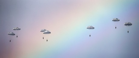 Russian paratroopers jump past rainbow from an IL-76 transport plane during a joint Serbian-Russian military training exercise 'Slavic Brotherhood' in the town of Kovin