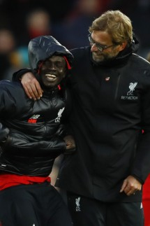 Liverpool manager Juergen Klopp and Sadio Mane celebrate after the game