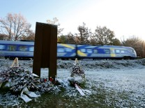 A train passes a memorial in Bad Aibling near Rosenheim