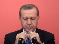 Turkish President Erdogan files criminal complaint against main o