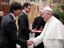 Pope Francis greets Germany's coach Joachim Low during a private audience with German national soccer team at the Vatican