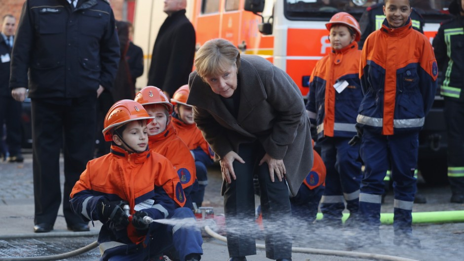 Merkel Visits Youth Fire Department Ahead Of Integration Summit