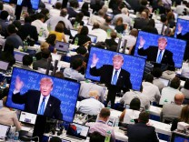 Republican presidential nominee Donald Trump is seen on television screens at the media room during the first presidential debate with U.S. Democratic presidential candidate Hillary Clinton at Hofstra University in Hempstead