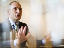 Liechtenstein's PM Adrian Hasler gestures during an interview with Reuters in Vaduz