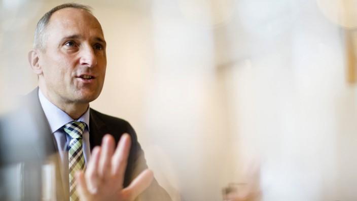 Liechtenstein's PM Adrian Hasler gestures during an interview with Reuters in Vaduz