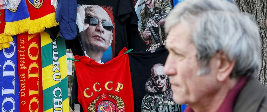 T-shirts depicting images of Russia's President Vladimir Putin and former USSR coat of arms are on sale at the street in central Chisinau