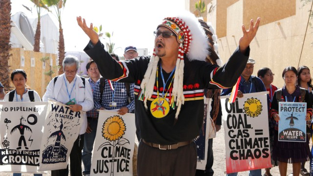 Representatives of different indigenous groups from various countries protest during the UN Climate Change Conference 2016 (COP22) in Marrakech