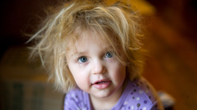 Young girl in pajamas with bedhead