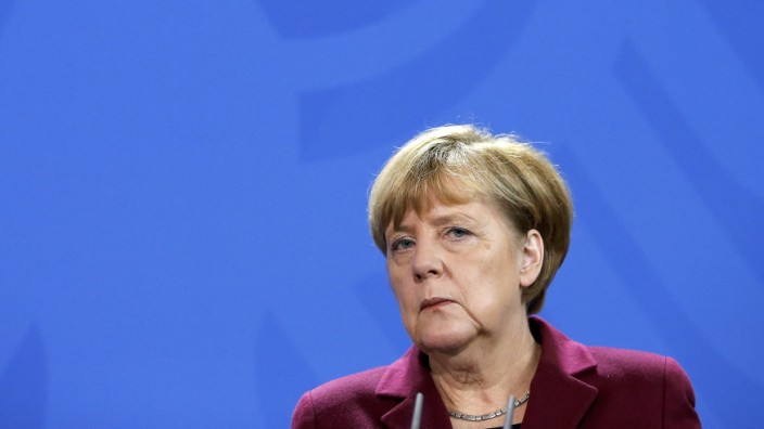 German Chancellor Merkel looks on during a joint news conference with Spain's Prime Minister Rajoy at the chancellery in Berlin