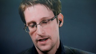 Edward Snowden speaks via video link during a news conference in New York City