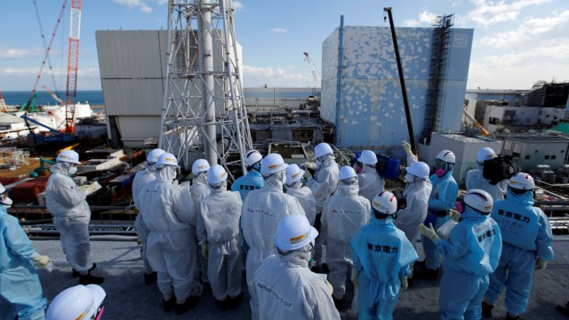 Members of the media receive briefing from Tokyo Electric Power Co. employees at tsunami-crippled Fukushima Daiichi nuclear power plant in Okuma town, Fukushima prefecture