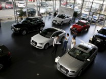 File photo of customers looking at cars at an Audi dealership from the Baoxin Auto Group in Shanghai