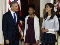 Sasha and Malia Obama join their father at the National Thanksgiving Turkey pardoning at White House in Washington