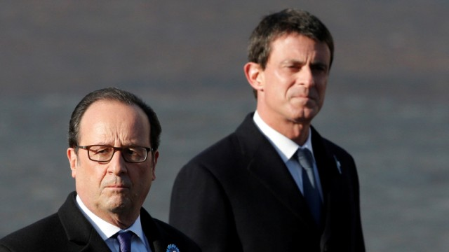 France's President Francois Hollande and Prime Minister Manuel Valls review troops as they attend a commemoration ceremony for Armistice day in Paris