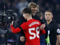 Liverpool's Ben Woodburn and manager Juergen Klopp celebrate after the game