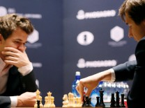 Sergey Karjakin of Russia makes a move against his opponent Magnus Carlsen of Norway during round 12 of the 2016 World Chess Championship match in New York