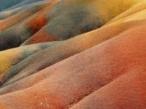 This stock photo shows a abstract view of the Coloured Earth Hills of Chamarel on the island of Maur