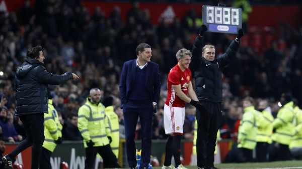 Manchester United's Bastian Schweinsteiger prepares to come on as a substitute as West Ham United manager Slaven Bilic and Manchester United assistant manager Rui Faria look on