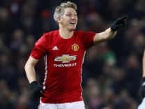 Manchester United's Bastian Schweinsteiger gestures as West Ham United's Sofiane Feghouli looks dejected