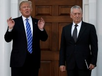File picture of U.S. President-elect Donald Trump with retired Marine Gen. James Mattis following their meeting at the main clubhouse at Trump National Golf Club in Bedminster