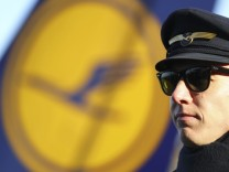 A pilot takes part in a demonstration during a strike of the German airline Lufthansa pilots at Frankfurt airport
