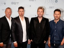Juno Nominees Nickelback arrive on the red carpet for the 2016 Juno Awards in Calgary