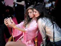 Model Gigi Hadid gets ready backstage before the Victoria's Secret Fashion Show at the Grand Palais in Paris