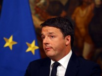 Italian Prime Minister Matteo Renzi looks on during a media conference after a referendum on constitutional reform at Chigi palace in Rome