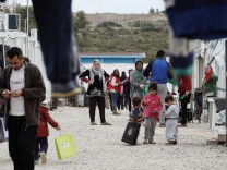 Families living in the refugee camp of Ritsona, north of Athens,