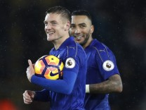 Leicester City's Jamie Vardy with the match ball at the end of the match after scoring a hat-trick