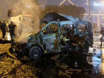 A damaged vehicle is seen after a blast in Istanbul